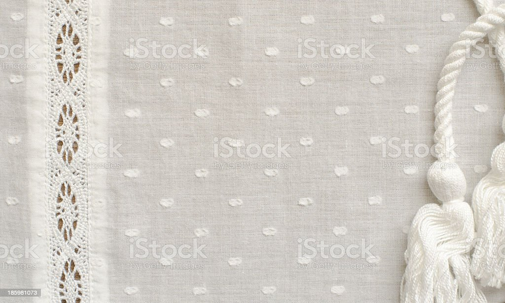 White fabric with a strip of lace royalty-free stock photo