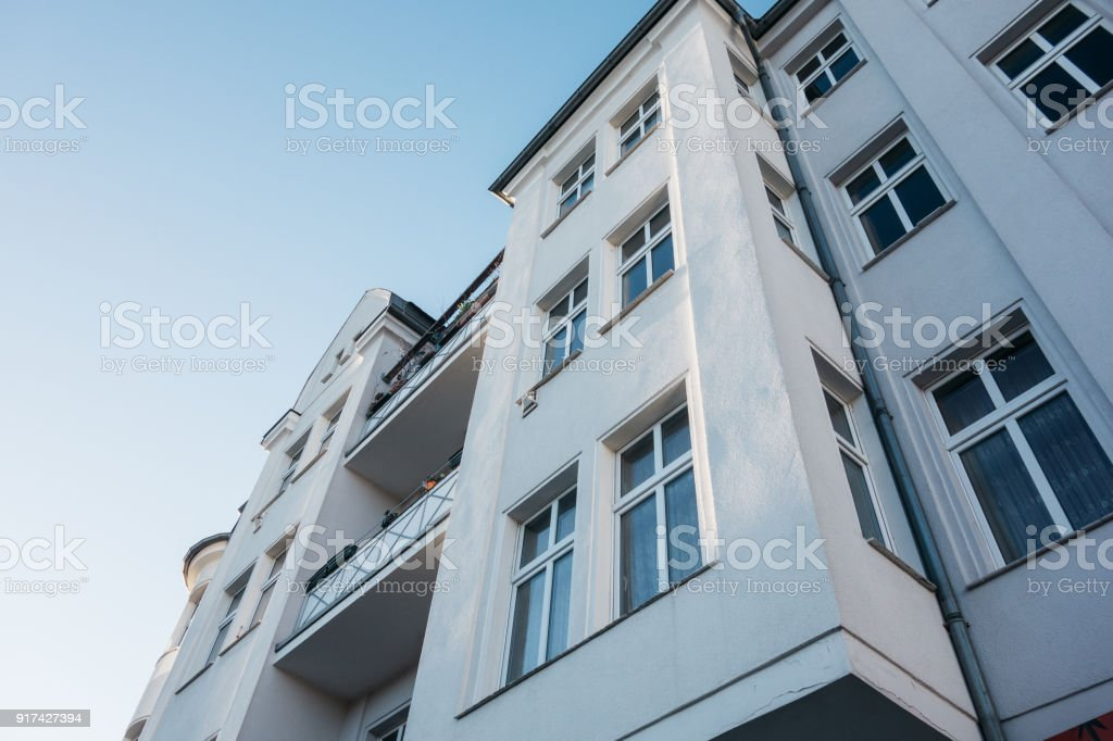 white facaded house in low angle view stock photo