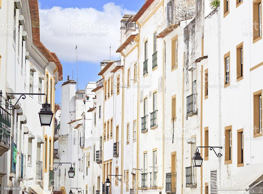 White facades old urban street in Evora. Alentejo, Portugal stock photo