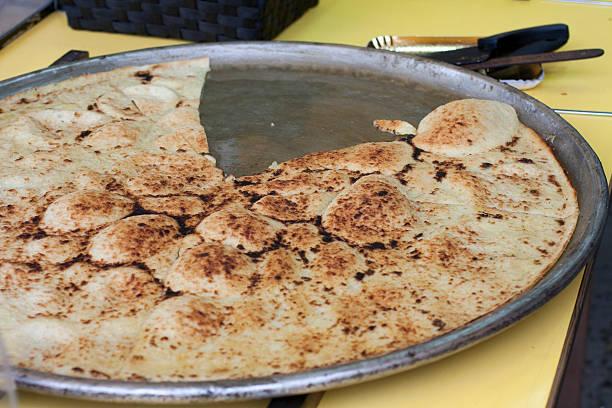 white farinata, italian street food white farinata, made with white flour instead of chickpeas farinata stock pictures, royalty-free photos & images
