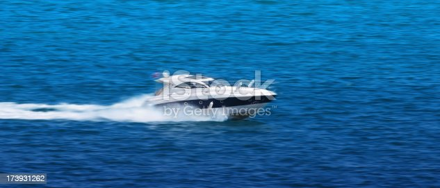 Powerboat drive fast at blue ocean.