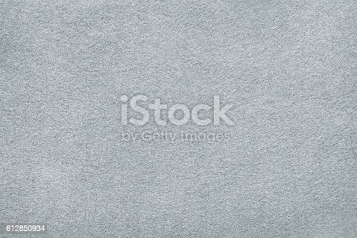 White or light gray felt background. Carpet, table surface or fabric texture