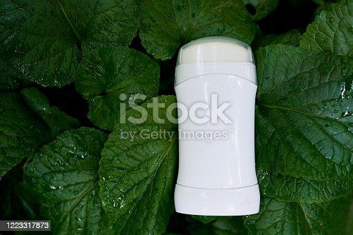 white female deodorant on nature green background