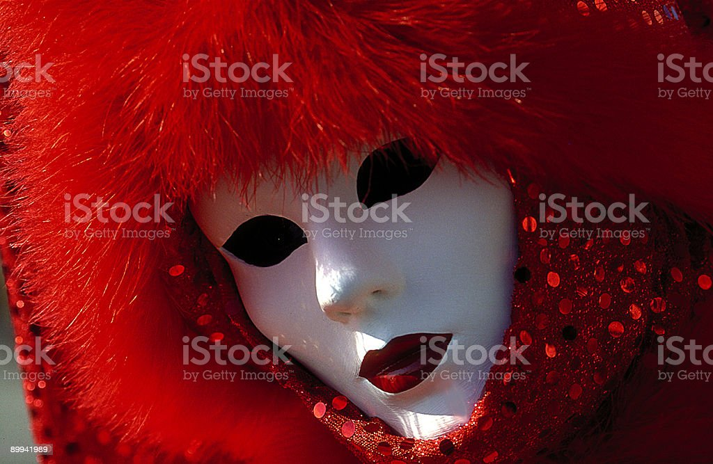 White female mask with red costume at carnival in Venice royalty-free stock photo
