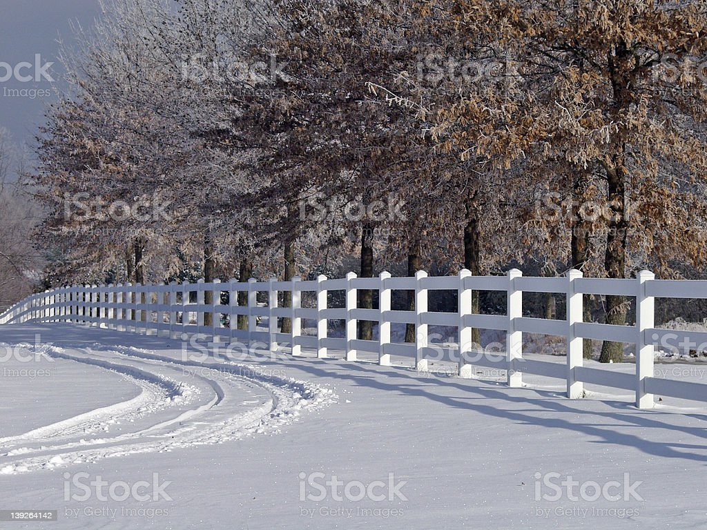 White fence in winter royalty-free stock photo