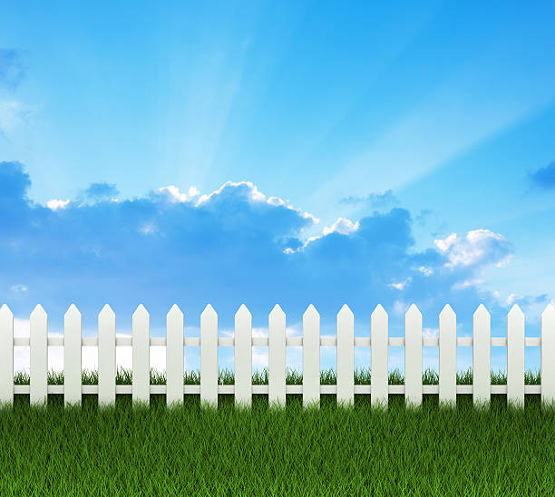 white fence - palisade boundary stock photos and pictures