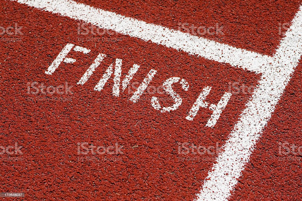 White Finish line on red track royalty-free stock photo