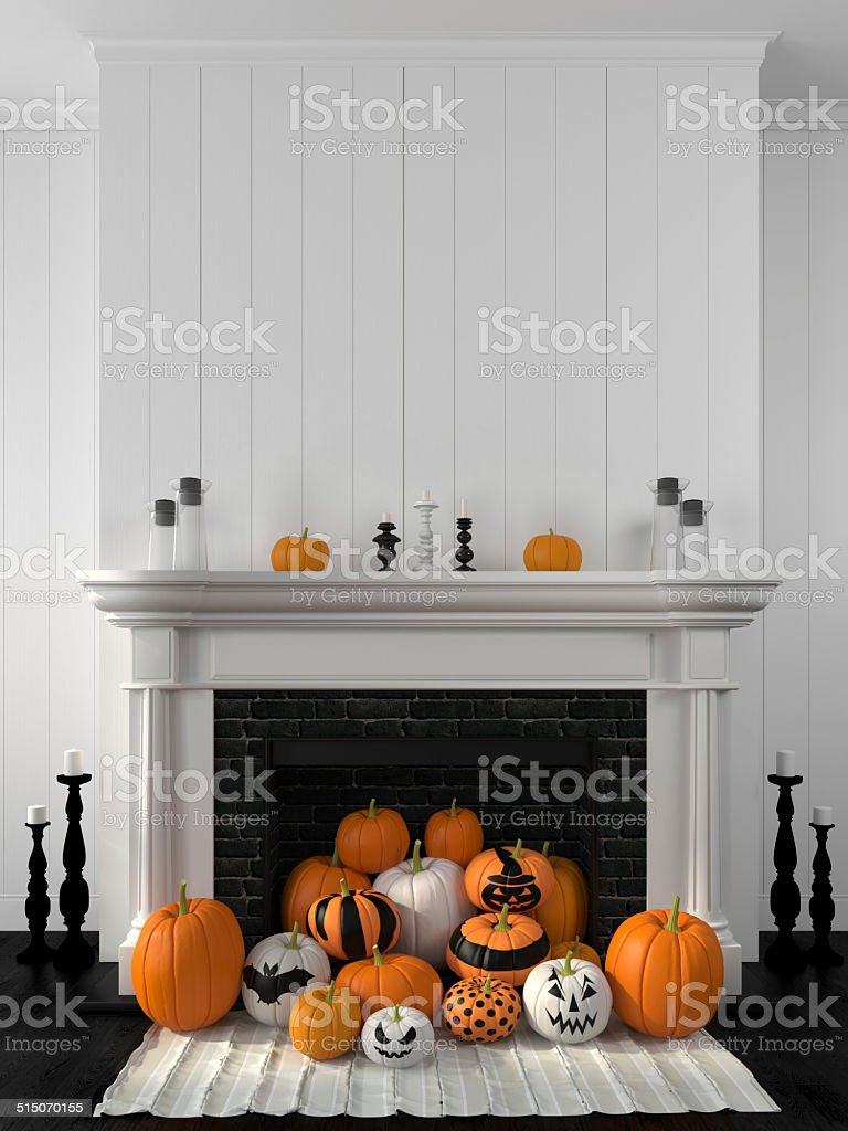 White fireplace decorated with pumpkins for Halloween stock photo