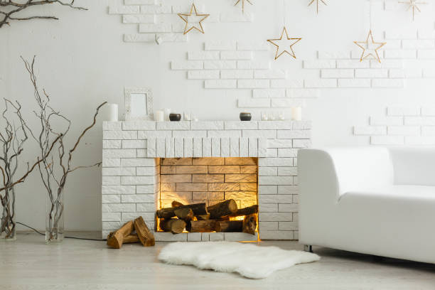 White fireplace in light room with Christmas decoration White fireplace in light room with Christmas decoration christmas interior stock pictures, royalty-free photos & images