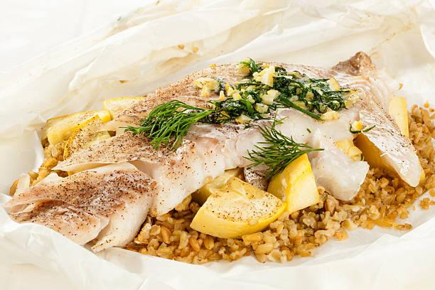 White fish en Papillote with freekeh dinner stock photo