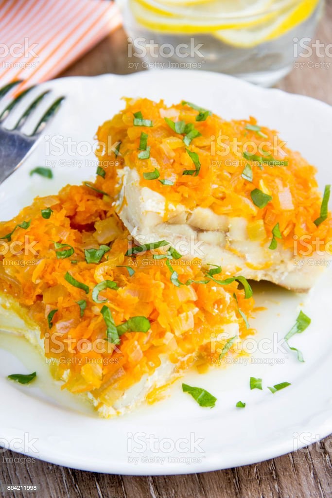 White fish fillet baked with carrots, onions, tasty dish of Russian cuisine, dinner for children royalty-free stock photo