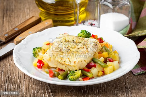 istock White fish fillet with vegetable stew, cod, sea bass, tilapia, perch, corn, broccoli, potatoes, bell peppers, beans, healthy food, tatsy homemade lunch 886069302