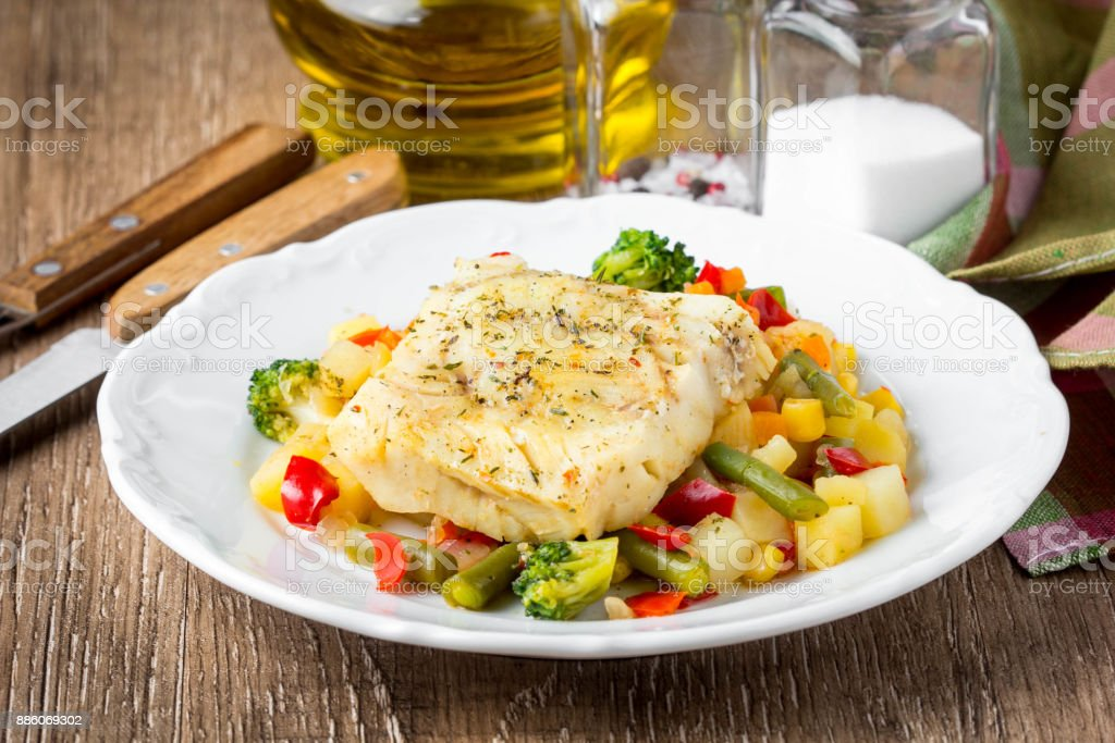 White fish fillet with vegetable stew, cod, sea bass, tilapia, perch, corn, broccoli, potatoes, bell peppers, beans, healthy food, tatsy homemade lunch stock photo