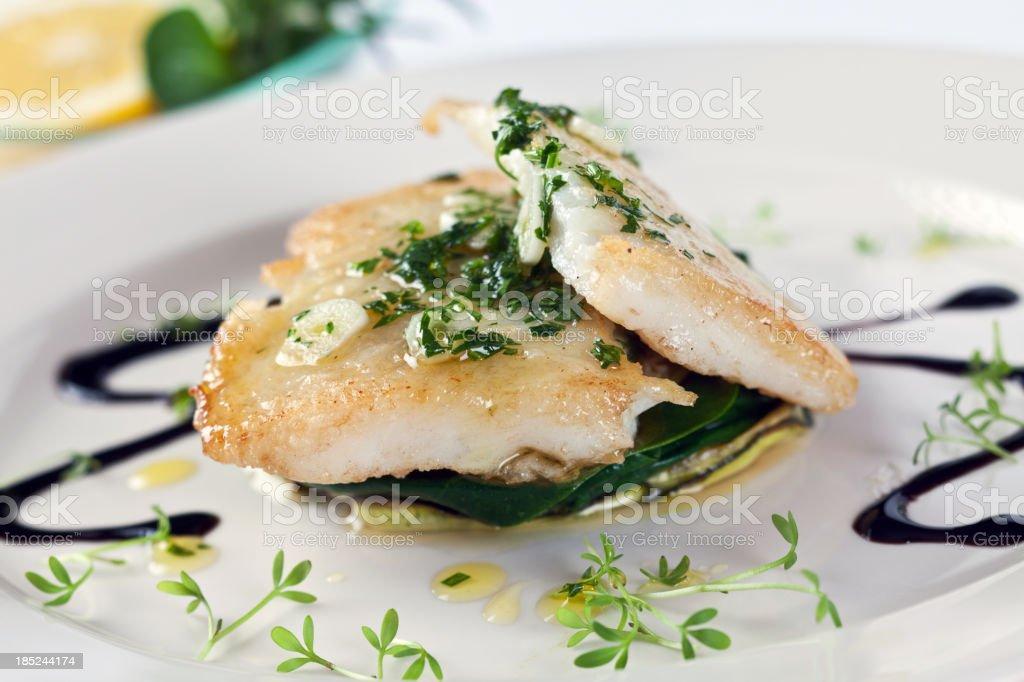 White fish on vegetable stock photo