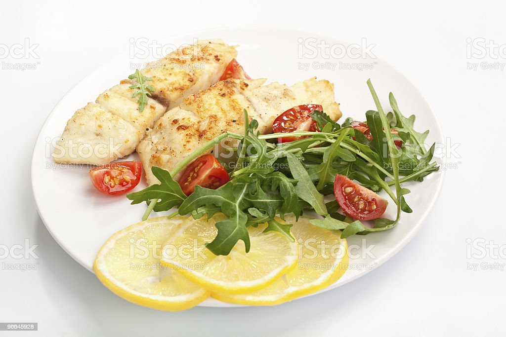 white fish with vegetables and lemon royalty-free stock photo