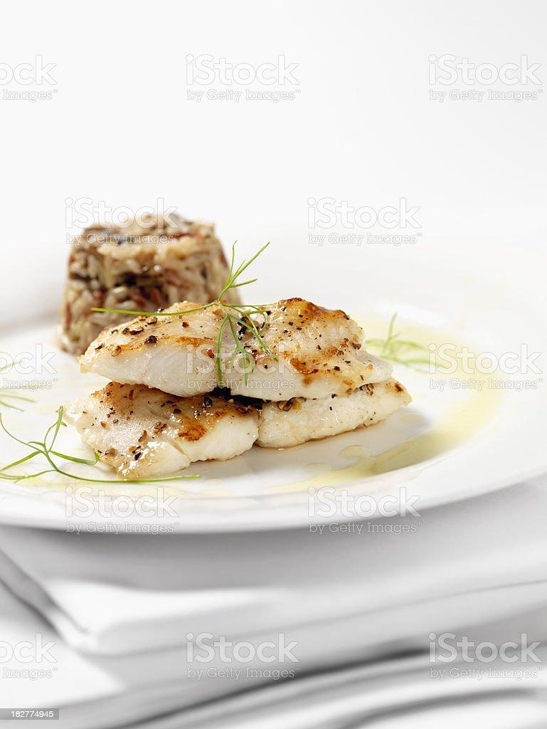 White Fish with Wild Rice & Garlic Butter Sauce stock photo