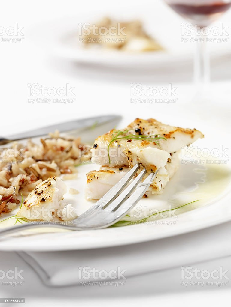 White Fish with Wild Rice & Garlic Butter Sauce royalty-free stock photo