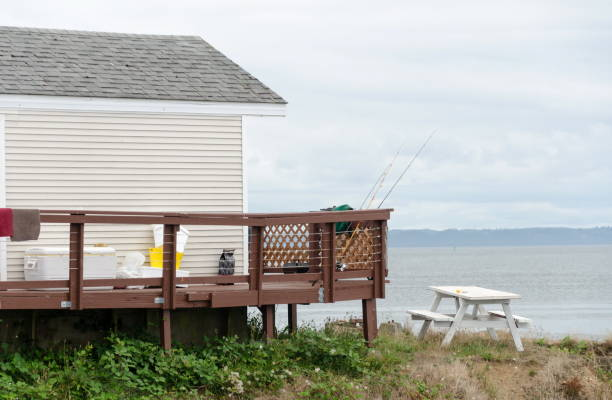 White fisher cabin with rods on the brown deck near Westport marina, Grays Harbor stock photo