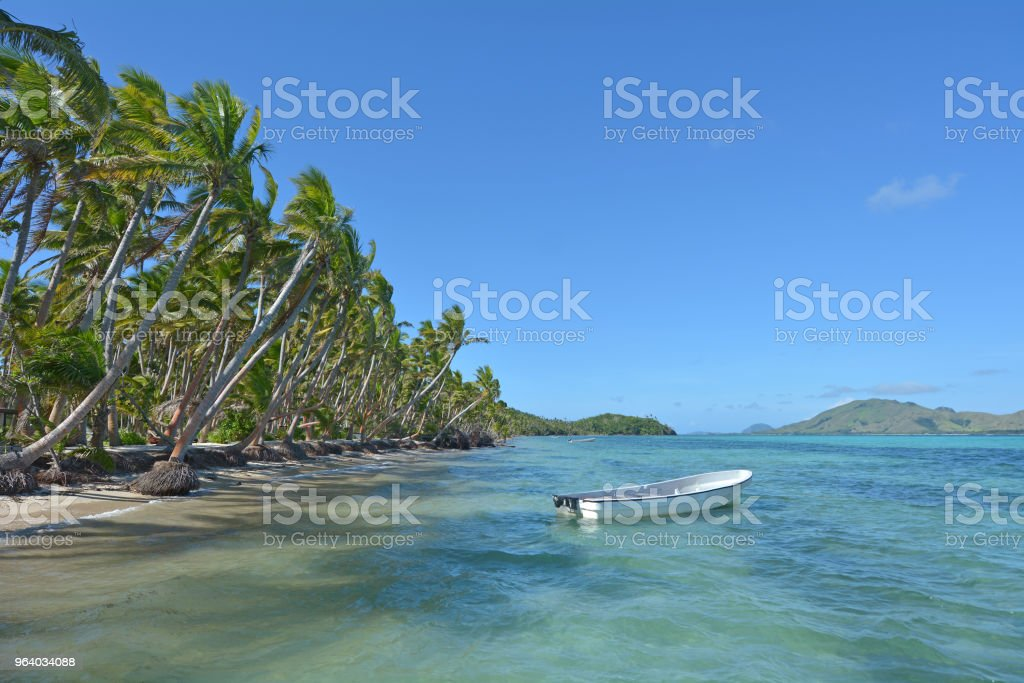 White fishing boat on a tropical island Fiji - Royalty-free Beach Stock Photo