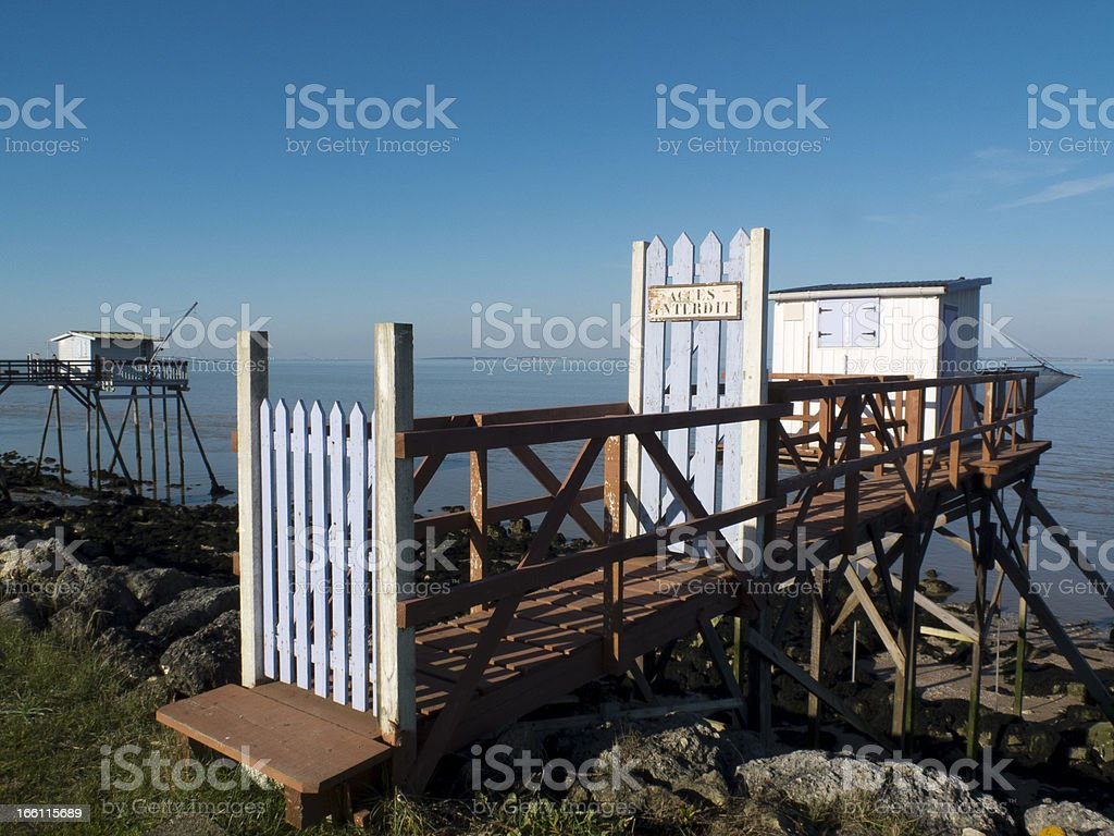 White fishing cabin stock photo