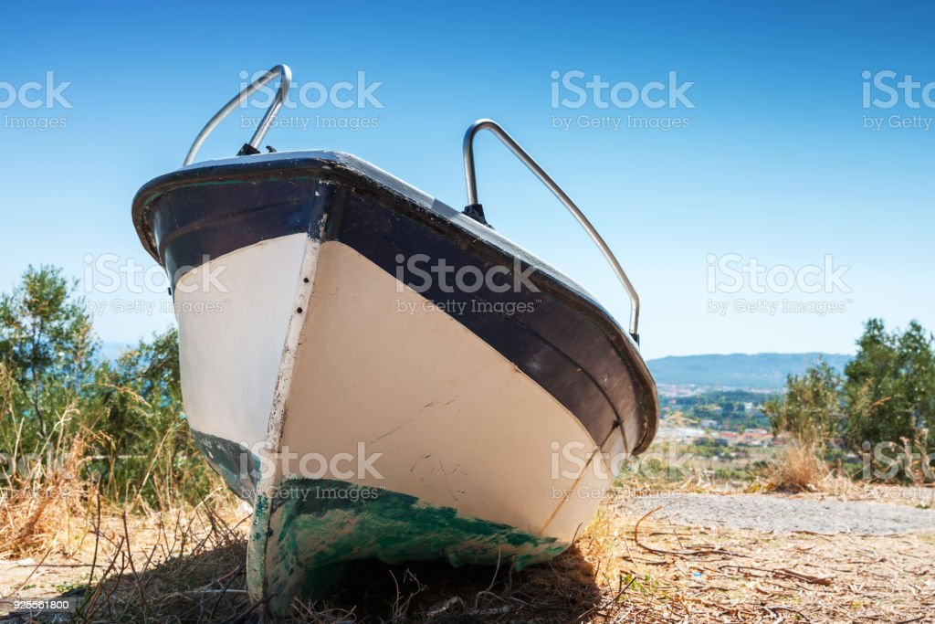 White fishing row boat on the coast. Summer landscape of Zakynthos...
