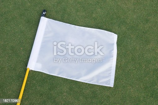 High angle view of a white flag with copy space on a putting green