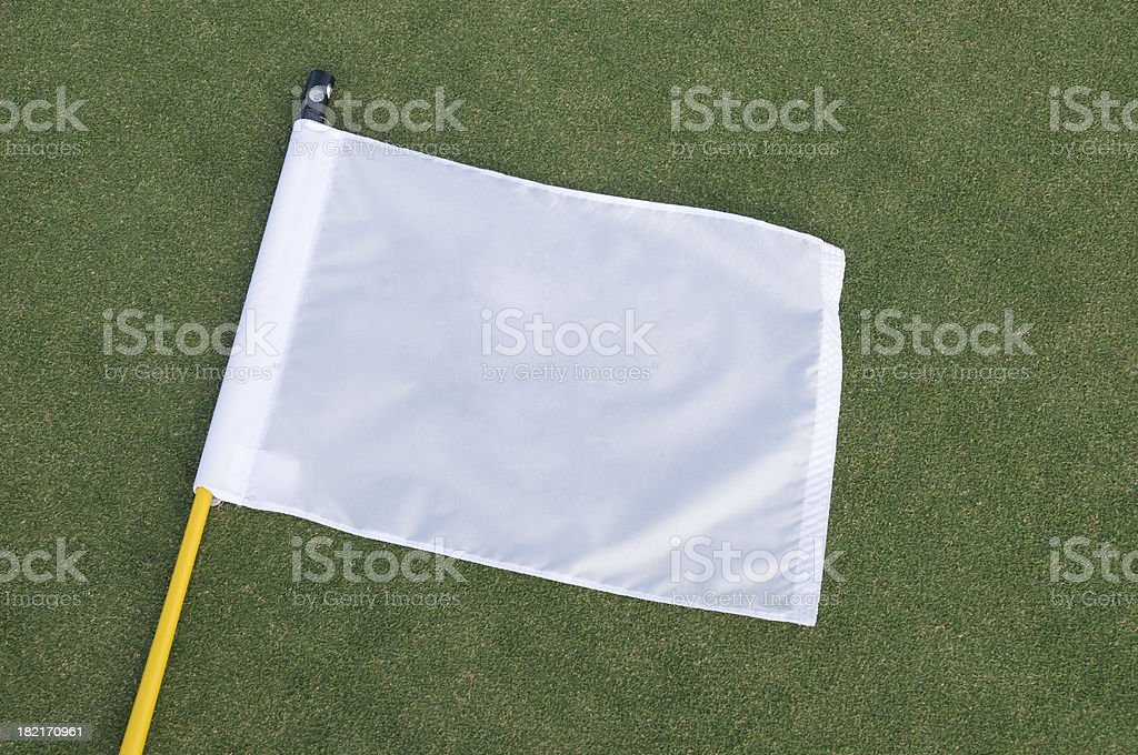 White flag on a putting green stock photo