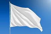 White flag on clear blue sky