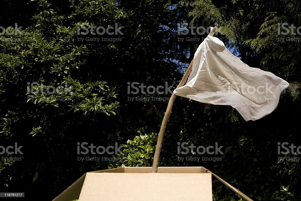 White flag outside blowing in the wind. royalty-free stock photo