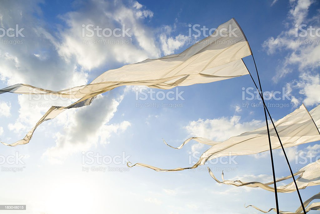 White Flags against Sun stock photo