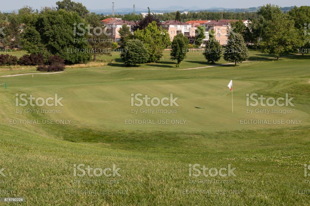 White Flagstick in Green Golf Course in Sunny Day stock photo