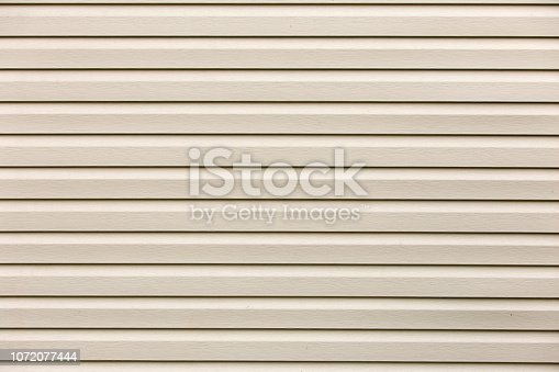 Abstract shiny white flat horizontal surface glamour texture. Vinyl plastic planks, boards siding,copy space background, retro pattern wall. Decoration, construction and repair concept.