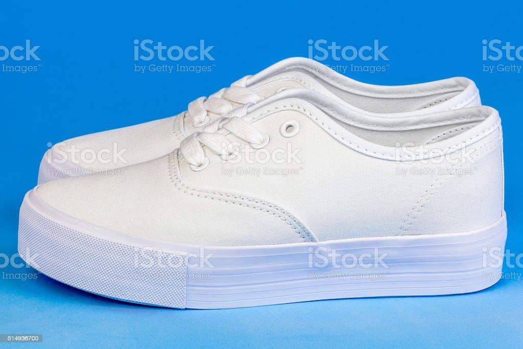White Flatform Plimsolls on blue