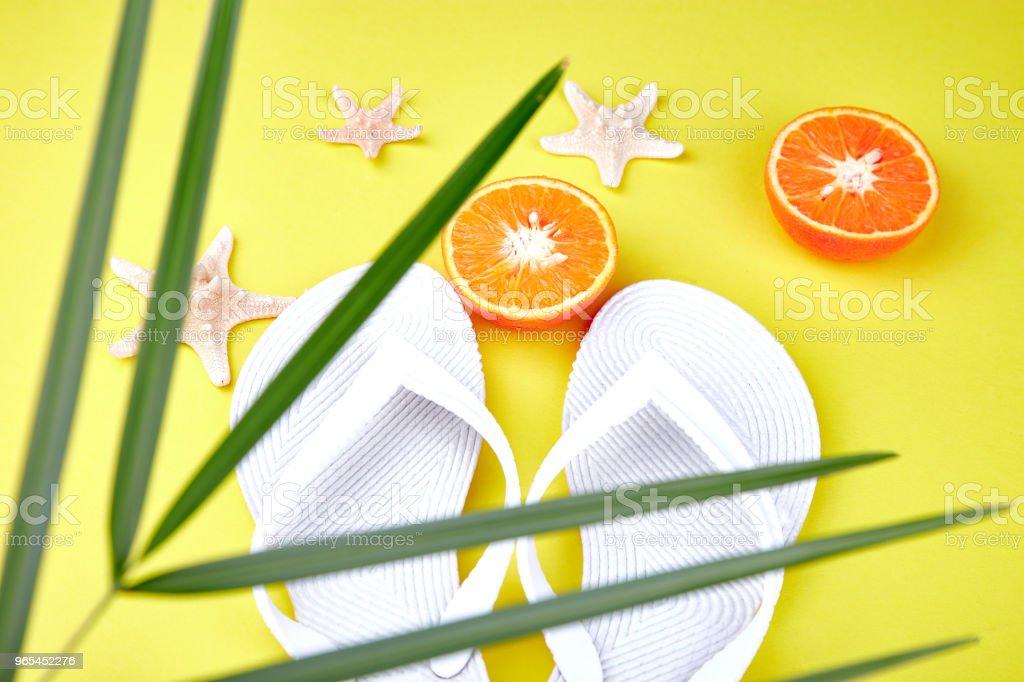 White Flip flops, Orange fruit, starfish and palm royalty-free stock photo