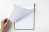 white flipped paper on clipboard isolated on white
