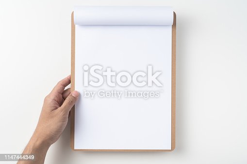 istock white flipped paper on clipboard isolated on white 1147444349