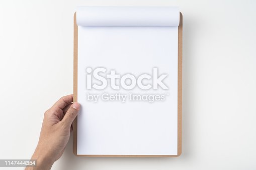 istock white flipped paper on clipboard isolated on white 1147444354