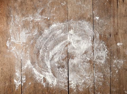istock white flour on wooden table 627448602