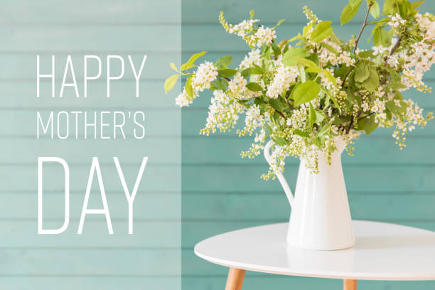 white flowers in a vase, mother's day concept - mothers day stock pictures, royalty-free photos & images