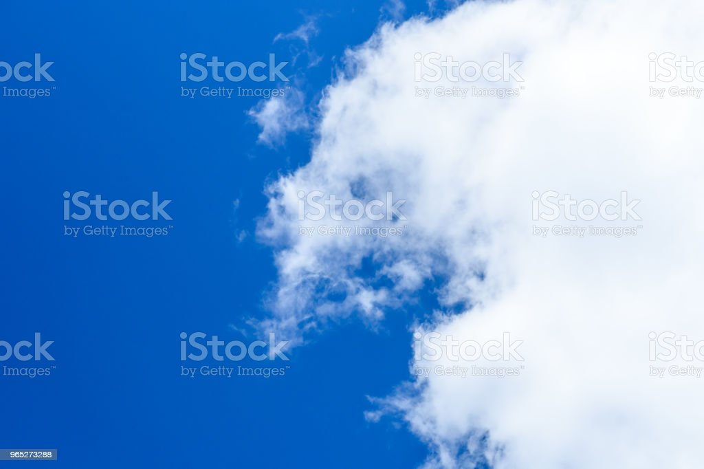 White fluffy clouds in a deep blue sky royalty-free stock photo