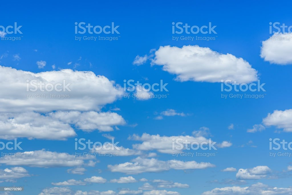 White fluffy clouds in a deep blue sky zbiór zdjęć royalty-free