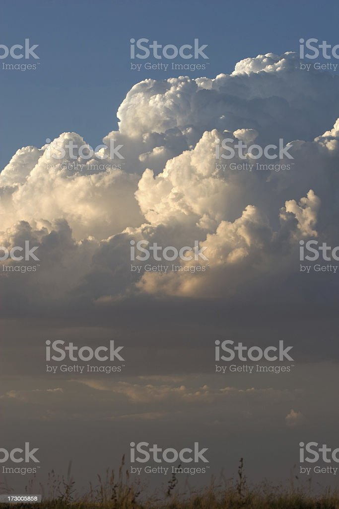 White Fluffy Cumulus Nimbus Clouds in Dramatic Sky royalty-free stock photo