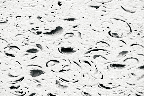 973649382 istock photo White foam block in macro. Foundation of old building. Detailed background from texture of foamed block close-up.Template of construction from foamed material. Pattern with copy space. 976362730