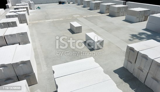 istock White foamed lightweight concrete (aerated concrete block) in under construction industrial building. Background with negative space (copy space). 1197309888