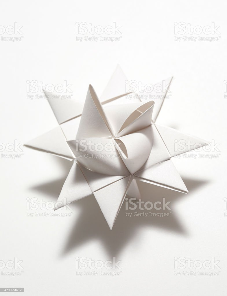 white folded paper origami moravian star decoration stock