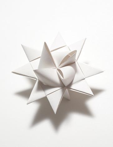 White folded paper origami Moravian Star decoration