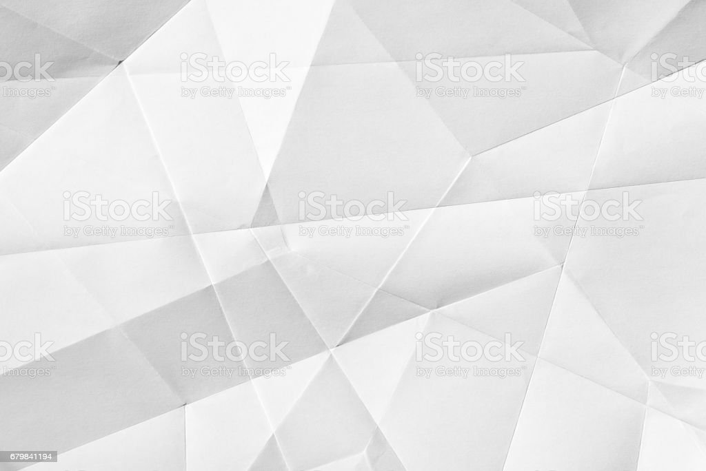 White folded paper White folded sheet of paper showing an abstract texture design under the light grazing. Good to use as background Abstract Stock Photo