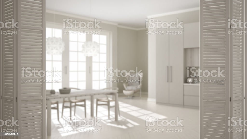 Witte vouwdeur opening op de klassieke keuken met eettafel en grote