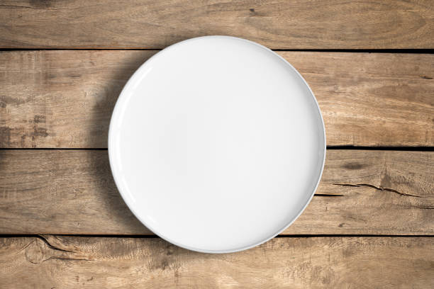 white food plate - plate stock pictures, royalty-free photos & images