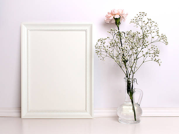 white frame mockup with flowers. - desktop foto stock-fotos und bilder